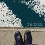 JC Townsend | GhOStS (looking down at two feet in shoes at the edge of water)