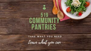 "A picture with text. The picture is planks of wood, tightly placed beside each other. On the top right is a plate of food salad with arugula and tomatoes. There are two wooden spoons beside the plate sitting on a gingham cloth.  in Green text in the middle of the page is ""519 Community Pantries"" and below that in white text is ""Take what you need. Leave what you can."""
