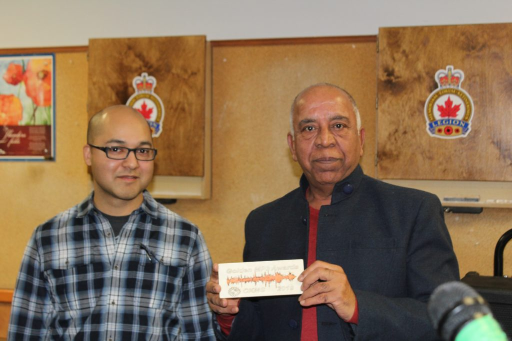 Nat Persaud with Narendra Grover holding his Golden MP3 Award plaque