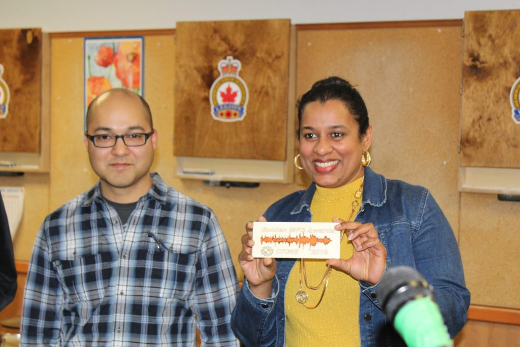 Nat Persaud with Rashmi Sanjay holding her Golden MP3 Award plaque