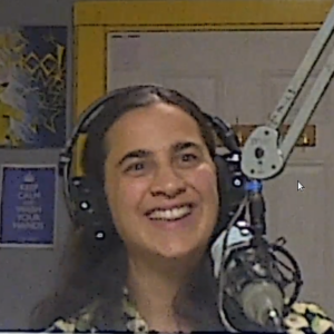 Amanda Di Battista at the microphone