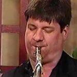 (headshot of Andy Klaehn playing saxophone)