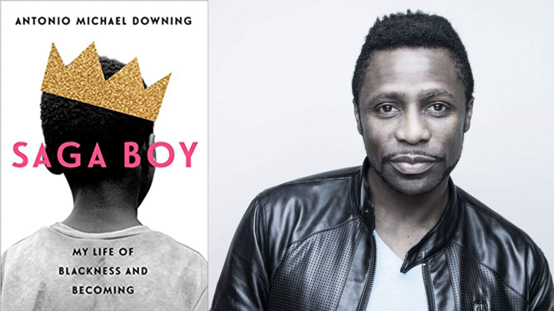 "The cover of the book ""Saga Boy: My Life of Blackness and Becoming"" with a young black boy with his head looking directly away from the camera, wearing a white tshirt and a golden paper crown tilted on his head. the back ground is white and the text is in black and pink."