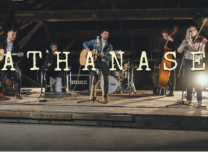 Athanase (letters over a picture of the band playing on a rustic stage)