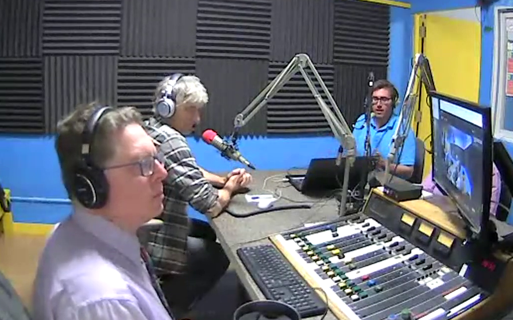 Bob Jonkman, Jeff Stager, and Brian Doucet in the studio at the microphones