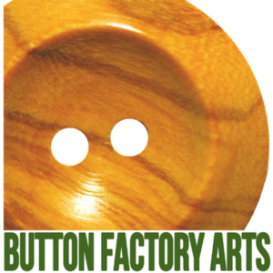 Button Factory Arts words under a wooden button)