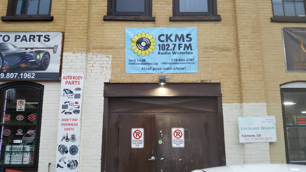 The CKMS 102.7 FM Radio Waterloo banner over the doors!