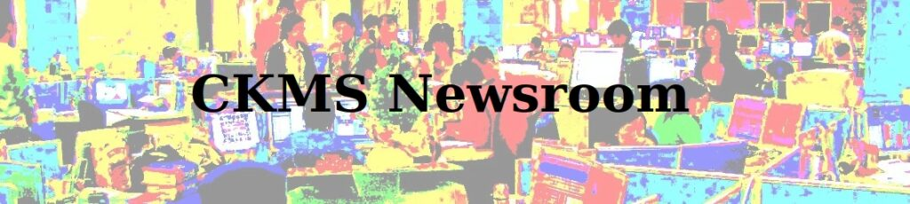 CKMS Newsroom (background of a busy newsroom, oversaturated colour)