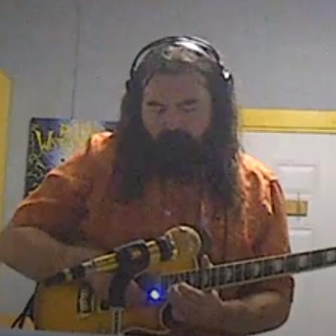 Chris Sherren playing guitar in Radiuo Waterloo Studio B
