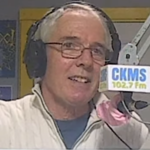 Chuck Howitt at the CKMS 102.7 FM microphone