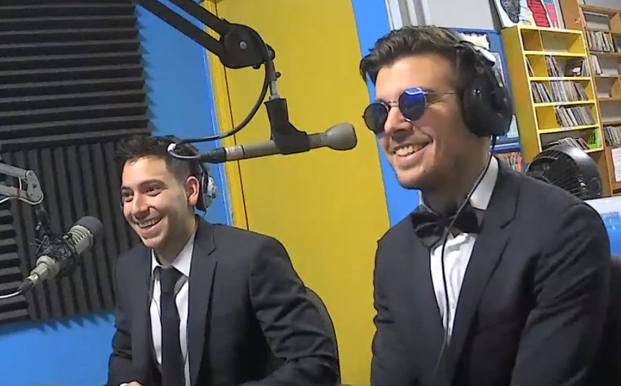 Crash and Adams sitting in the studio at the microphones