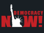 Democracy Now! (silhouette of the Statue of Liberty holding a microphone, used as the 'O' in 'Now')