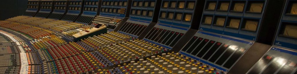 Knobs and sliders on a large recording console