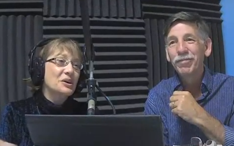 Elizabeth McCallister and Mark Kempf at the microphone