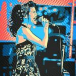 (solarized image of Ginger St. James singing and holding a microphone)