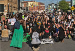 Thousands of people kneel with their fists raised at the Black Lives Matter march in Kitchener on June 3rd 2020