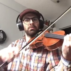 Jeremy Gignoux playing the fiddle