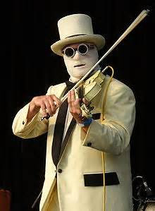 (Nash The Slash in his bandages stage costume playing his white electric violin)
