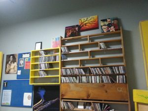 Wall-mounted racks of CD cases and sleeves