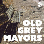 Old Grey Mayors (park bench on a leafy sidewalk)