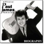 official Paul James fanclub | Biography (Paul James holding a guitar behind his neck)