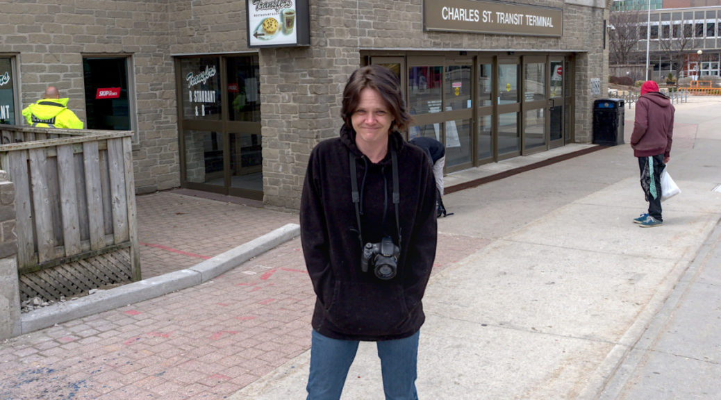Regan Sunshine Brusse in front of the unused bus Terminal building in downtown Kitchener.