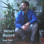 Attract Hazard | Sam Nabi (album cover) Sam Nabi  crouches in front of some plants an dhis stereo