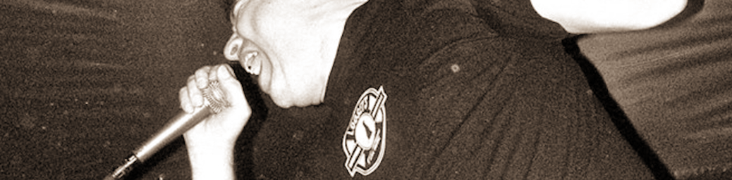 (cropped sepia toned image of Jason Scheurs screming into a microphone)