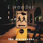i wonder | the macqueens (a pedestrian crossing sign above a pedestrian beg button)