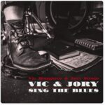 Vic Ruggiero & Jory Kinjo | Vic & Jory Sing The Blues (a foot with an untied boot stepping on a tambourine)