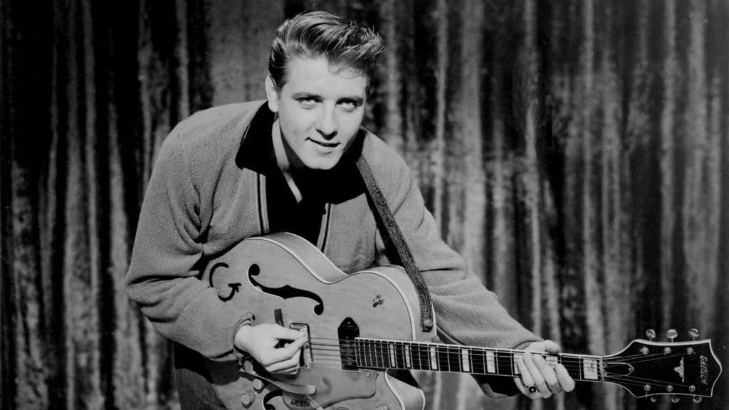 Eddie Cochcran holding a guitar