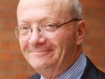 Headshot photo of a grinning Hugh Segal.