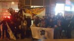 Workers, clients, and supporters of the International Workers' Centre in Montreal are standing in front of the office.