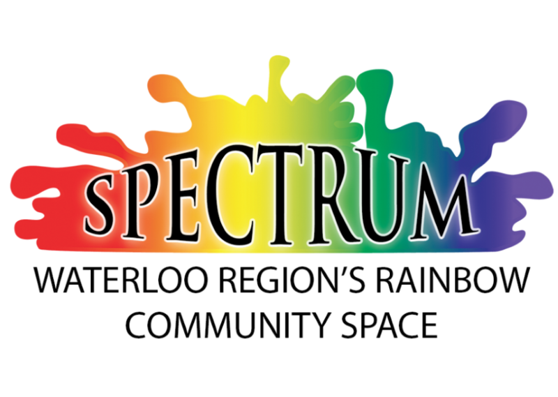 """The spectrum logo featuring a stylized colour blob which follows the rainbow from red to purple. The word """"Spectrum"""", in black serif text with a white outline, is overlain on the spectrum. Somewhere under the rainbow the words in black non-serif text reads """"Waterloo Region's Rainbow Community Space."""