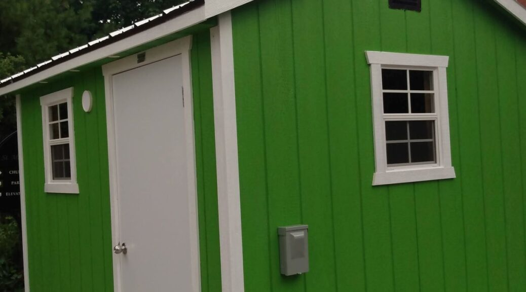 "A close up of a green cabin built for the ""A Better Tent City"" project."